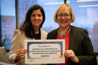Camille Quenneville, CEO of CMHA Ontario, and Gail Czukar, CEO of AMHO, making their pledge to quality improvement for Change Day Ontario.